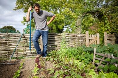 Gardener Resting in Vegetable Garden