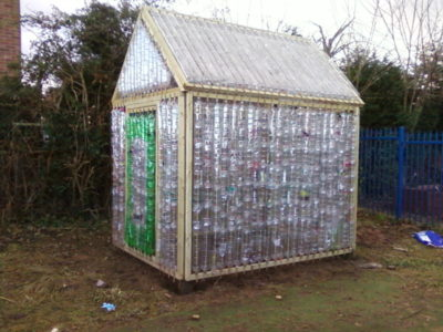 8 inexpensive diy greenhouse ideas anyone can build off for Homemade greenhouse plastic